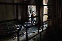 An Egyptian inspects debris in a room of the Jesuit College compound in Minya that was damaged after being torched. A wave of attacks on the Christian minority has washed over Egypt, as Islamists set upon homes and churches, shops and schools, youth clubs and at least one orphanage
