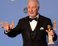 """Producer Jerry Weintraub holds his trophy  in the press room after winning Best Mini-Series or TV Movie for """"Behind the Candelabra"""" during the 71st Annual Golden Globe Awards in Beverly Hills, California, January 12, 2014.(ROBYN BECK - AFP/Getty Images)"""