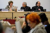 From left: Kirsten Sandberg, Monsignor Silvano Tomasi and Vatican prosecutor Charles Scicluna get ready for Thursday's session to begin.