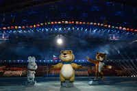 The Winter Games' official mascots, the Leopard, the Polar Bear and the Hare, perform during the opening ceremony.ANDREJ ISAKOVIC - AFP/Getty Images