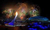 Fireworks light the sky over the Fisht Olympic Stadium as the flame is ignited.PETER PARKS - AFP/Getty Images