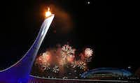 Fireworks light the sky outside the Fisht Olympic Stadium as the Olympic flame is lit.LOIC VENANCE - AFP/Getty Images
