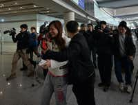 A scene at the Beijing Airport after news of the missing Malaysia Airlines Boeing 777-200 on Saturday. Malaysia Airlines said a flight carrying 239 people from Kuala Lumpur to Beijing lost contact with air traffic control.(MARK RALSTON - AFP/Getty Images)