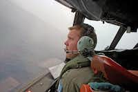 Marc Smith of the Royal Australian Air Force helps fly an AP-3C Orion aircraft searching for the downed jet.Richard Wainwright - Presse
