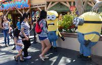 People dressed as Minions attract visitors at Universal Studios where the Despicable Me Minion Mayhem attraction was still under construction on February 14, 2014 in Universal City, California.FREDERIC J. BROWN -  Getty Images
