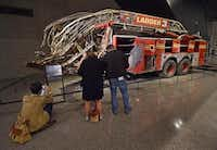 The front of the New York City Fire Department Ladder Company 3 truck was shorn off in the 9/11 attack at the World Trade Center. It stands past the battered Survivors Staircase that hundreds used to escape the burning towers,( Stan Honda  -  Getty Images )