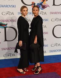 Ashley Olsen and  Mary-Kate Olsen attend the 2014 Council of Designers of America Awards (CFDA)at Alice Tully Hall at the Lincoln Center June 2, 2014 in New York City. AFP PHOTO / Timothy  A. CLARYTIMOTHY A. CLARY/AFP/Getty ImagesTIMOTHY A. CLARY - AFP/Getty Images