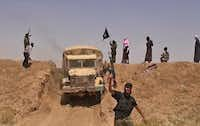 <bold>An image from a jihadist</bold> Twitter account shows what it says are militants on a road from Iraq's Ninevah province to the Syrian town of al-Hasakah.- - Baraka News
