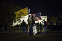 Activists opposed to President Barack Obama's immigration stance gathered outside the White House to show their dismay with the president's executive order Thursday night.(BRENDAN SMIALOWSKI - AFP/Getty Images)