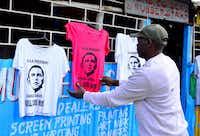 T-shirts bearing an image of President Barack Obama were on sale in Kibera, Kenya, on Wednesday ahead of Obama's upcoming visit to the country. Obama's family roots stretch from a small village in Kenya to the White House.(Kevin Midigo - Presse)