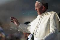 Pope Francis waves from the popemobile in Ciudad Juarez, Mexico. Throngs gathered at Mexico's border with the United States on Wednesday for a huge mass with Pope Francis highlighting the plight of migrants, a hot-button issue on the U.S. presidential campaign trail.( Pedro PARDO  -  AFP/Getty Images )