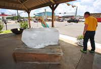 Hope and Matt Matchett of Terrell  stopped while passing through town to examine a large block of salt outside the Salt Palace on Main Street in downtown Grand Saline. The town's 41st annual Salt Festival is this weekend.(Louis DeLuca - Staff Photographer)