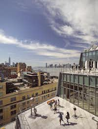 Terraces at the new Whitney offer expansive views. With 50,000 square feet devoted to gallery space, the eight-story building cost $422 million.(Nic Lehoux)
