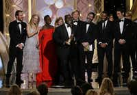 """Steve McQueen, center, accepted the award for best motion picture drama for """"12 Years a Slave"""" during the 71st annual Golden Globe Awards at the Beverly Hilton Hotel on Sunday, Jan. 12, 2014, in Beverly Hills, Calif.(Paul Drinkwater - AP/NBC)"""