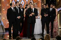 """Charles Roven, center, accepted the award for best motion picture comedy for """"American Hustle"""" during the 71st annual Golden Globe Awards at the Beverly Hilton Hotel on Sunday, Jan. 12, 2014, in Beverly Hills, Calif.(Paul Drinkwater - AP/NBC)"""