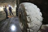 A large front-end loader's tires are covered with salt dust inside the Morton Salt Mine in Grand Saline.( Louis DeLuca  -  Staff Photographer )
