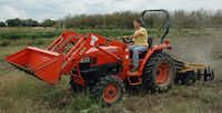 Matthew Weintrub, a senior horticulture major from Plano, takes to the tractor to prepare fields at Howdy Farm.