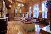 A large living area, with intricate paneling and moldings.