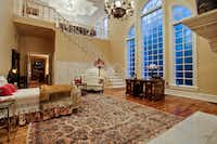 The master suite is two stories.