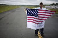 Former American Airlines ramp employee Jim Carlton greeted flights at Dulles Airport outside Washington with a U.S. flag for over a year after the 9/11 attacks. Carlton now flies a U.S. flag imprinted with the names of the victims from his house on the anniversary.