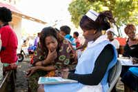 In Livingstone, Zambia, Eliza Tufule meets with a nurse at the Mosi-Oa-Tunya Health Center for her first cervical cancer test. Zambia has among the highest cervical cancer incidence rates in the world.
