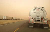 Blowing dust and wind speeds averaging 45 mph and gusting to 55 mph hampered drivers on Interstate 27 near Lubbock, Tex., on Wednesday, December 19, 2012.(Ariel Kirkland - Journal)