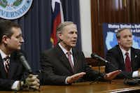 Governor Greg Abbott, center, speaks at a Capitol news conference on February 18, 2015 in Austin, Texas.