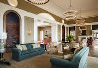 Fort Worth-based interior designer Ken Blasingame  designed the presidential offices and reception hall, private rooms in the Bush Institute, and a living room and large and small dining rooms for the Bushes' personal use. In the living room, Blasingame used teal velvet on the facing sofas and coral-and-teal floral upholstery on the chairs.