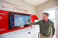 "Centex Plute Homes General Sales Manager Mike Goza points out the floor plan of the ""Brookmere"" currently available in the Paloma Creek South neighborhood in Little Elm, Friday, November 6, 2015. The Brookmere currently sales for $195,990.(Brandon Wade - Special Contributor)"