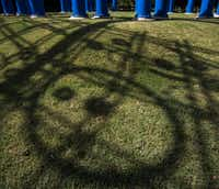 """Blueprints,"" a large outdoor sculpture designed by Texas-born artist Mel Chin in collaboration with landscape architect Michael van Valkenburgh, makes a shadow on the grass in the center of Addison Circle on Wednesday, June 24, 2015 in Addison, Texas.( Ashley Landis  -  Staff Photographer )"