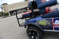 A golf cart, which belongs to members of the Balding Eagles Booster Club, bears a picture of Eagle Stadium while parked at Plano ISD's John Clark Stadium in Plano ISD.( Photos by ROSE BACA/neighborsgo staff photographer )
