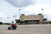 Members of the Balding Eagles Booster Club James Adams, Nolan Srader and Mark Kapocsi ride their Allen Eagle golf cart across the parking lot at Plano ISD's John Clark Stadium. The Allen football team will play at Plano ISD's stadiums this year, including John Clark Stadium.(Rose Baca)