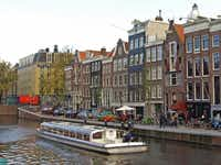 The flat-roofed four-story canal house on the right (next to the building with the pointed roof) houses the Secret Annex where Anne Frank and her family hid during World War II.Photos by Irv Green  -  Special Contributor