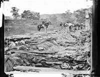 Ditch with bodies of soldiers on right wing used as a rifle pit by Confederates at Antietam, Maryland, September 1862.