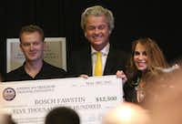 Bosch Fawstin (left), the winner of the cartoon contest, was presented with a check by Dutch politician Geert Wilders and Pamela Geller, the organizer of the event in Garland, on Sunday.(Gregory Castillo - Staff Photographer)