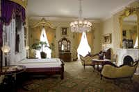 Laura Bush and decorator Ken Blasingame refurbished the Lincoln Bedroom in the White House, although the room did not exist in Lincoln's time. In White House archives they discovered a highly ornate Victorian bed that Mary Todd Lincoln had purchased, a sample of the wallpaper, and photographs of the rug that had been in Lincoln's office.