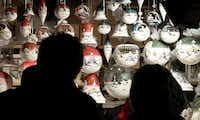 Shoppers shop original German glass christmas ornaments at the Christkindlmarket