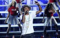 Pharrell Williams performs at the BET Awards at the Nokia Theatre on Sunday, June 29, 2014, in Los Angeles. (Photo by Chris Pizzello/Invision/AP)Chris Pizzello - Chris Pizzello/Invision/AP