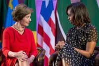 Former first lady Laura Bush and first lady Michelle Obama appeared at the Bush Institute's African First Ladies Summit on Tuesday in Dar es Salaam, Tanzania.