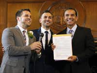 Newlyweds Jeff Zarrillo (left) and Paul Katami (center) posed for photos after their Los Angeles City Hall ceremony with Mayor Antonio Villaraigosa, their officiant.(Damian Dovarganes - The Associated Press)