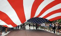 Members of the Gay, Lesbian and Bisexual Veterans Association march with a big U.S. Flag at the 45th Annual Chicago Pride Parade during the parade on Broadway Street in Chicago, Sunday, June 29, 2014. (AP Photo/Nam Y. Huh)Nam Y. Huh - AP