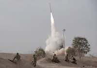 An Israeli Iron Dome missile is launched near the city of Be'er Sheva, southern Israel, to intercept a rocket fired from Gaza Saturday, Nov. 17, 2012. Israel bombarded the Hamas-ruled Gaza Strip with nearly 200 airstrikes early Saturday, the military said, widening a blistering assault on Gaza rocket operations to include the prime minister's headquarters, a police compound and a vast network of smuggling tunnels. (AP Photo/Ahikam Seri)(Ahikam Seri - AP)