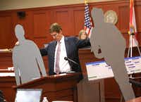 In arguing that George Zimmerman killed Trayvon Martin in self-defense, attorney Mark O'Mara used cutouts to show that the teenager was taller.Joe Burbank / The Associated Press