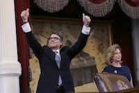 Gov. Rick Perry acknowledged applause next to wife Anita before giving a farewell speech to a joint session of the Texas Legislature.