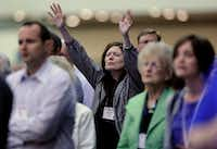 Michelle Ray, of West Plains, Mo., raises her hands in praise during the Southern Baptist Convention's annual meeting Tuesday, June 10, 2014 in Baltimore. The Southern Baptist Convention is the nation's largest Protestant denomination, with 15.7 million members, but leaders are concerned about recent membership declines. (AP Photo/Steve Ruark)Steve Ruark - AP