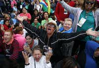 Inocencia Polanco (in hat) of Philadelphia, originally from the Dominican Republic, Freddy Espana (left) of Honduras and Maria Zuleta (in front) of Colombia prayed ahead of Pope Francis' speech Saturday outside Independence Hall.(Carolyn Kaster - AP)
