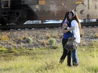 "Parade participants react after a trailer carrying wounded veterans in a parade was struck by a train in Midland, Texas, Thursday, Nov. 15, 2012. ""Show of Support"" president and founder Terry Johnson says there are ""multiple injuries"" after a Union Pacific train slammed into the trailer, killing at least four people and injuring 17 others. (AP Photo/Reporter-Telegram, James Durbin)James Durbin - AP"