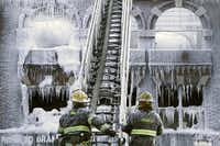 Philadelphia firefighters work the scene of an overnight blaze in west Philadelphia, Monday Feb. 16, 2015, as icicles hang from where the water from their hoses froze.(Jacqueline Larma - AP)