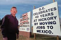 Gary Hefner, president of a union chapter in North Carolina, put up signs in Hickory, N.C., in 1997 after General Electric closed its plant there and moved production to Mexico. Hefner worked at the U.S. plant, making electrical transformers, for 30 years.( File Photo  -  The Associated Press )