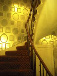 A stairwell and hallway at Arnaud's Restaurant have wallpaper with faux-mirror designs. Maitre d' James Homrighausen says his night kitchen manager avoids that area: 'I see faces in those mirrors,' she says.